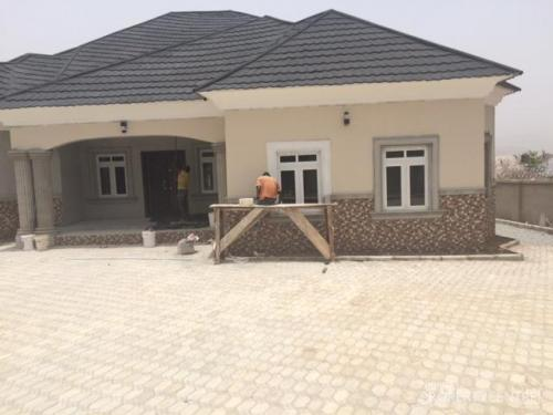 1 brand new 4 bedroom bungalow situated on 900 square for Latest bungalow design gallery