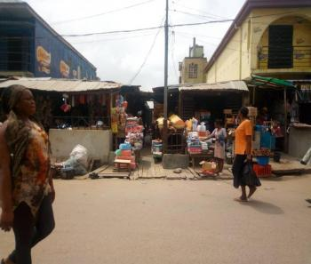 a Well Drained and Partly Fenced Land on 246.41sqm with 8 Shops, 15, Oniwaya Road, Agege, Lagos, Commercial Property for Sale